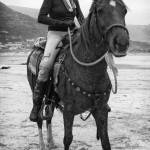 Nicky, a horse rider on her horse on Noordhoek Beach
