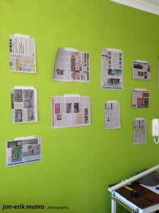 hanging newspaper on the wall to help visualise where the prints will go
