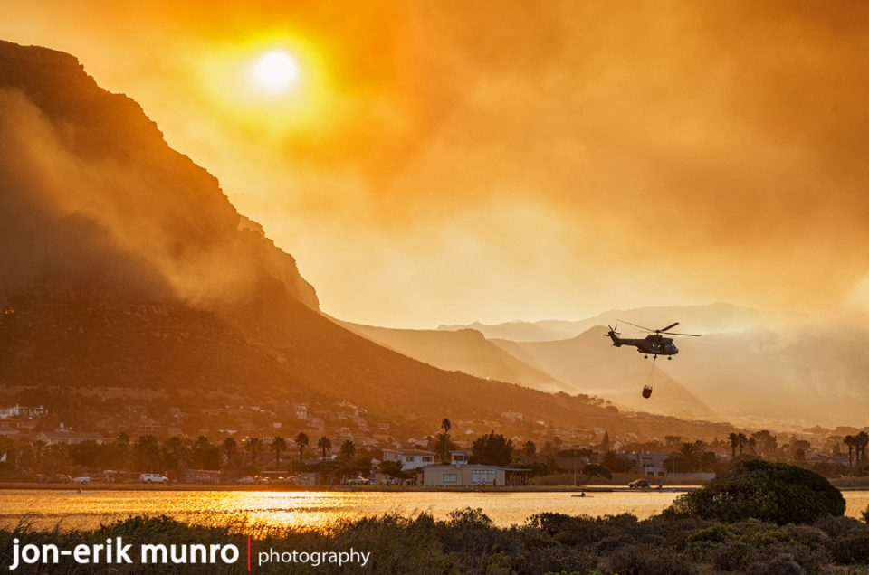 An Oryx flies with a Bambi bucket during the recent fires in Cape Town